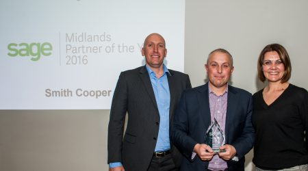 Richard Brewster and Chris Smith receiving award from Nikola McNicol-Kenney VP, New Customer Acquisition UK at Sage UK